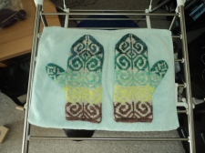 green/brown fiddlehead mittens